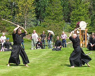 Kenjutsu -  Modern kenjutsu practitioners giving a demonstration at the Devonian Botanical Garden in Devon, Alberta, Canada (2005).
