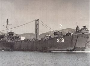LST-938 entering San Francisco Bay having just passed under the Golden Gate Bridge as she returns from duty in the South Pacific, 27 May 1946