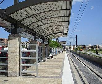 Las Colinas Urban Center station - Passengers waiting on DART Orange Line train.