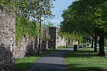 The remains of the abbey's stone precinct walls date from the 13th century