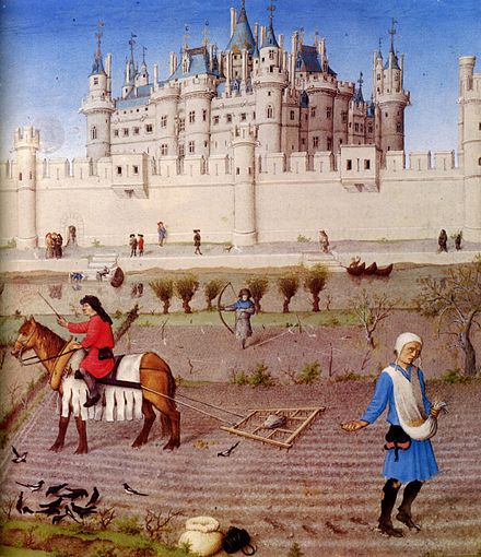 The peasants preparing the fields for the winter with a harrow and sowing for the winter grain. The background contains the Louvre castle, c. 1410 Les Tres Riches Heures du duc de Berry octobre detail.jpg