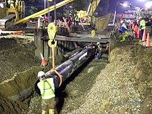 220px-Lifting_pipe_-_Enbridge_Oil_spill_