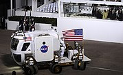 President Obama, Michelle Obama and Vice President Biden watch as NASA's Lunar Electric Rover demonstrates how its 12 wheels can pivot independently.