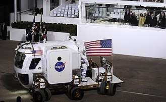 Space policy of the Barack Obama administration - President Obama, Michelle Obama and Vice President Biden watch NASA's Lunar Electric Rover at the 2009 inaugural parade.