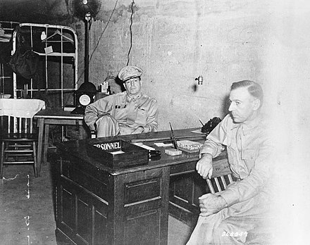 MacArthur (center) with his Chief of Staff, Major General Richard K. Sutherland, in the Headquarters tunnel on Corregidor, Philippines, on 1 March 1942 MacArthur and Sutherland s265357.jpg