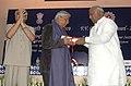 Mallikarjun Kharge presenting the V.V. Giri Memorial Award – 2009 to the Professor of Economics, JNU, Dr. Ravi S. Srivastava, instituted by the V.V. Giri National Labour Institute, in New Delhi on August 10, 2010.jpg