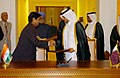 Manmohan Singh and the Prime Minister and Foreign Minister of Qatar, Sheikh Hamad bin Jassem bin Jabor al Thani witnessing the exchanging signed documents of an agreement on Defence and Security co-operation between the.jpg