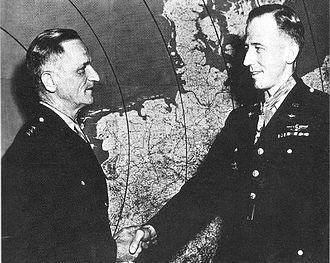James H. Howard - Howard receiving the Medal of Honor from Lieutenant General Carl Spaatz