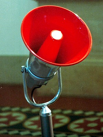 Electronic red megaphone on stand.