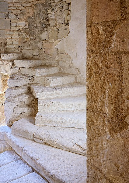 Walls and remains of the stone spiral staircase in the abbey of la Frenade, Merpins, Charente, France.