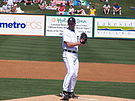 A Detroit Tigers pitcher getting ready to deliver a pitch during a baseball spring training game.