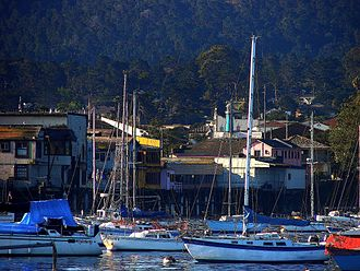 Monterey, California - Fisherman's Wharf and downtown rooftops,  seen from  Monterey Bay