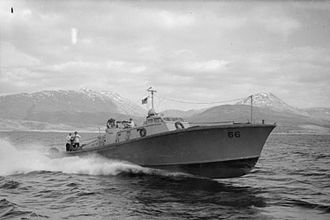 Motor Gun Boat - MGB 66 at speed with the crew at action stations, off the coast of Scotland