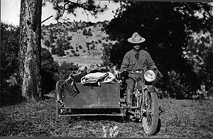 History of wildfire suppression in the United States - A US Forest Service motorcycle firefighter, with equipment in sidecar, 1917