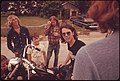 Motorcyclist Loading His Possession on a Truck with the Help of His Friends at Leakey, Texas, near San Antonio, 05-1973 (3703575549).jpg