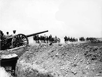 London Heavy Brigade, Royal Garrison Artillery - Transport limbers gallop past a battery of British 4.7 inch guns on the Somme