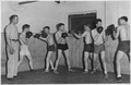 """NYA-Boise, Idaho-""""man on the left is able to attend Boise Jr. College by teaching a class on the Art of Self Defense... - NARA - 197135.tif"""