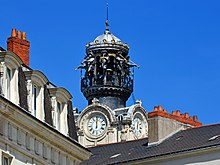 Ornate church belfry against a blue sky