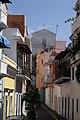 Narrow street in Old San Juan buildings with church.jpg