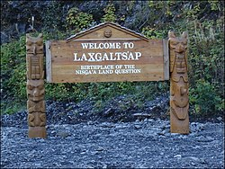 Laxgalts'ap/Greenville, BC. Entrance sign carved by Merlin Robinson