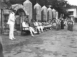 History of Guam - Commander Willis W. Bradley, USN (seated at left), Naval Governor of Guam, attends Arbor Day exercises at the Governor's Palace, Agana, Guam circa 1930.