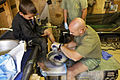 Navy 'Doc' Cleans the Burnt Foot of a Child at Patrol Base Gorgak, Helmand province, Afghanistan.jpg