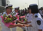 Navy Officers are greeted on the pier by the People's Liberation Army (Navy) during a welcoming ceremony in Shanghai. (26817318036).jpg