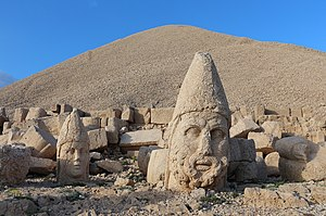Antiochus I Theos of Commagene - Statues of gods and the pyramid-like tomb-sanctuary of King Antiochus Theos of Commagene rising behind, atop Mount Nemrut