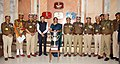 Nirmala Sitharaman in a group photograph with the officials of Indo Tibetan Border Police (ITBP), during the presentation ceremony of the Best Marching Contingent trophies for Republic Day Parade 2018, in New Delhi.jpg
