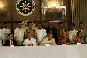 Aleem Said Ahmad Basher - His excellency President Benigno S. Aquino III signed into law the postponement of election in ARMM Region at the Ceremonial Hall in Malacanan Palace, Manila on June 30, 2011. (Seated L-R) Senate President Juan Ponce Enrile, President Aquino III, House Speaker Belmonte Jr., Representative Bai Sima. (Standing L-R) Datu Ansari Alonto, Aleem Said Basher, Dr. Hamid Barra, Aleem Jaafar Ali, Dr. Disomimba were invited to witness the signing ceremony.