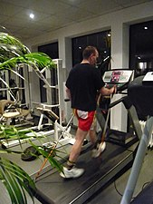 English: Nordic walking on a treadmill in a he...