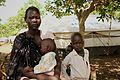 Nyaduk Jok, 19, is alone with her infant son and young sister. Her husband stayed in Nassir to fight. (14950150999).jpg