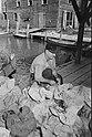 OlgaTyingOysterSacks1938.jpg
