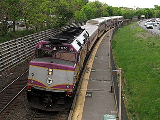 MBTA Commuter Rail - A typical Commuter Rail train, consisting of one diesel locomotive and five coaches, at Auburndale station in 2012.