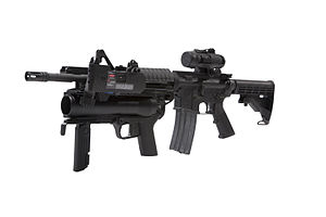 M320 Grenade Launcher Module - The M320 with electronic targeting system mounted on the M4 carbine.