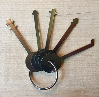 Lock picking - A common set of skeleton keys used to open most types of warded padlocks
