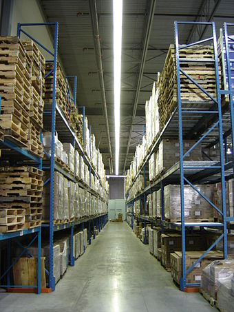 Aisle with pallets on storage racks in a modern warehouse Pallet racks.jpg