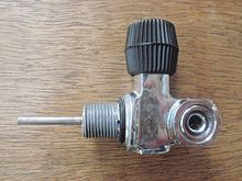 A cylinder valve showing a DIN plug fitted.