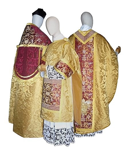 Renaissance styled vestments which is used by the Catholic clergy: A chasuble, dalmatic, cope, and a biretta Parato-pontremoli-1.jpg