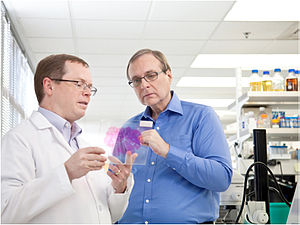 Paul Allen - Paul G. Allen (right) studies a brain sample with Allen Institute for Brain Science's CEO Allan Jones.