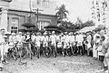 People on the bikes before the office building of Sinhua.jpg