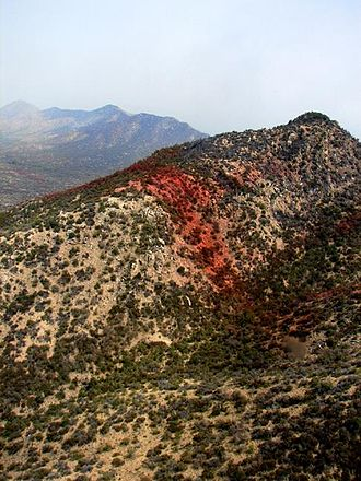 Fire retardant - Red-dyed line of fire retardant stands out clearly on this Arizona hill, to control the Alambre Fire