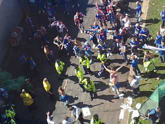 2008 UEFA Cup Final riots - Officers of the Greater Manchester Police keep Rangers and Zenit fans apart