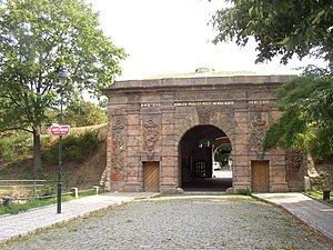 Písek Gate - Outer side of the gate with decoration advertising military strength of the Habsburg monarchy