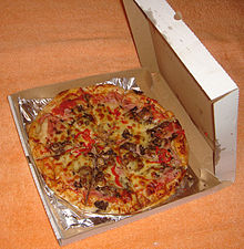 An open pizza box with a pizza inside