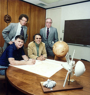 Carl Sagan - The Planetary Society members at the organization's founding. Carl Sagan is seated on the right.