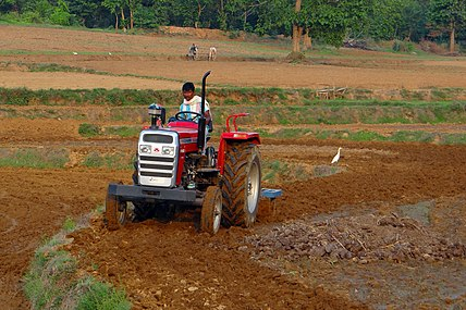 Plowing the land in India - modern and traditional.jpg