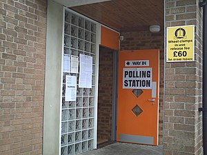 United Kingdom local elections, 2007 - Entrance to a polling station in the market town of Haverhill, Suffolk on 3 May 2007. The posters on the left are lists of the candidates in wards contested (St Edmundsbury BC and Haverhill TC) and information about rules and laws about voting.