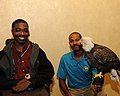 Posing for picture with Bald Eagle. (10595221074).jpg