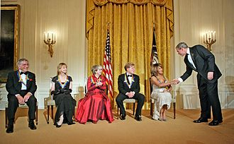 Tina Turner - U.S. President George W. Bush congratulates Tina Turner during a reception for the Kennedy Center Honors in the East Room of the White House on December 4, 2005. From left, the other honorees are singer Tony Bennett, dancer Suzanne Farrell, actress Julie Harris, and actor Robert Redford.